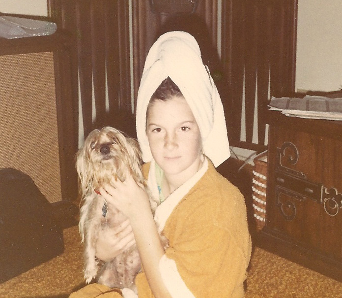 Tenley Myers with her little rat looking silky terrier and fresh out of the shower.